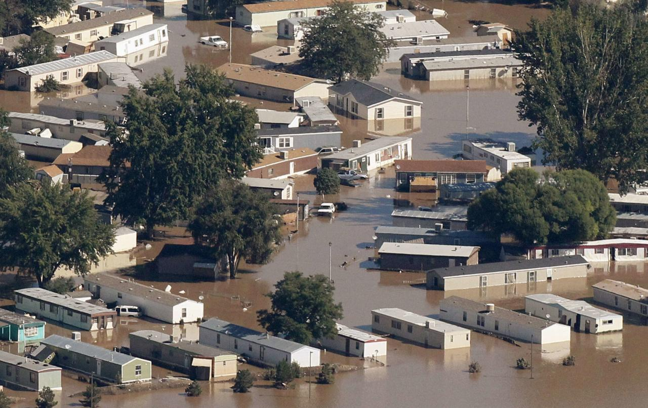 Mobile homes lie flooded in the of town of Evans, Weld County, Colorado in this September 17, 2013 file photo. The mobile home park was left in shambles and partially submerged in water where trailers were swept off their foundations by runoff from a solid week of rains that started September 9. REUTERS/Rick Wilking/Files (UNITED STATES - Tags: DISASTER ENVIRONMENT)