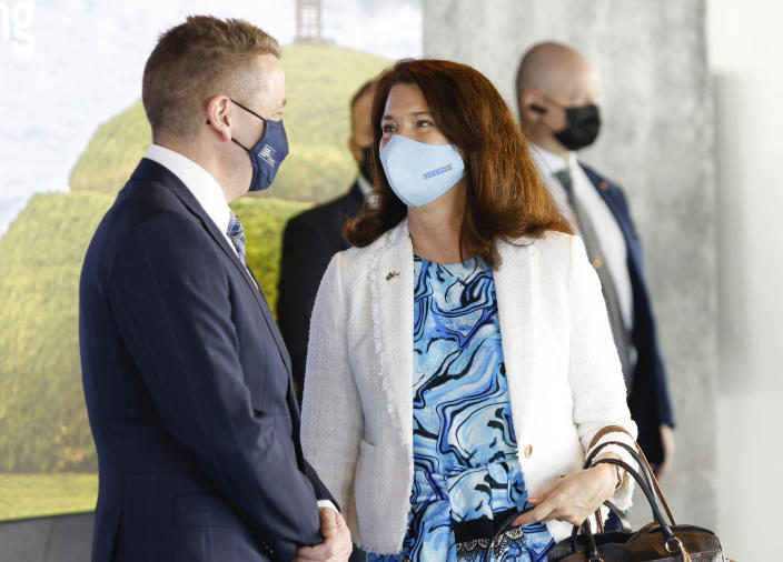 Swedish Minister of Foreign Affairs Ann Linde is greeted by Icelandic Minister of Foreign Affairs Gudlaugur Thor Thordarson as she arrives for the Arctic Council Ministerial Meeting in Reykjavik, Iceland, Thursday, May 20, 2021. (AP Photo/Brynjar Gunnarsson, Pool)