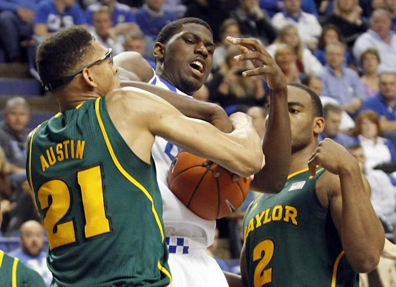 Kentucky's Alex Poythress, middle is wrapped up between Baylor's Isaiah Austin (21) and Rico Gathers (2) during the first half of an NCAA college basketball game at Rupp Arena in Lexington, Ky., Saturday, Dec. 1, 2012. (AP Photo/James Crisp)