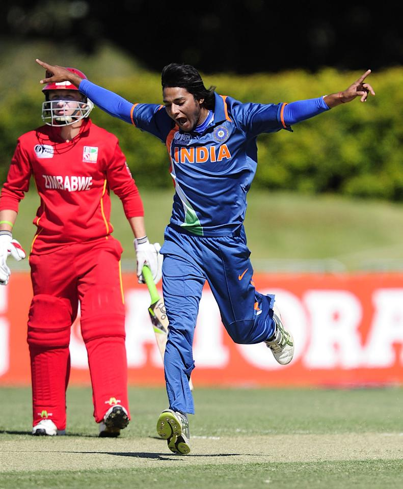 TOWNSVILLE, AUSTRALIA - AUGUST 14:  Kamal Passi of India celebrates taking a wicket during the ICC U19 Cricket World Cup 2012 match between India and Zimbabwe at Tony Ireland Stadium on August 14, 2012 in Townsville, Australia.  (Photo by Ian Hitchcock-ICC/Getty Images)