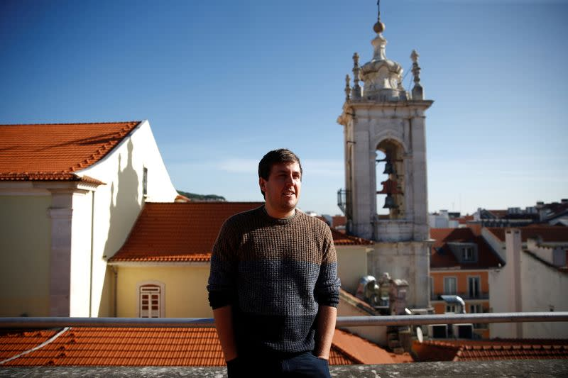 British citizen James Ellsmoor stands on his home terrace in Chiado, Lisbon