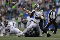 Tennessee Titans quarterback Ryan Tannehill (17) gets off an incomplete pass as he is tackled by Seattle Seahawks defensive end Rasheem Green, right, during the second half of an NFL football game, Sunday, Sept. 19, 2021, in Seattle. (AP Photo/John Froschauer)