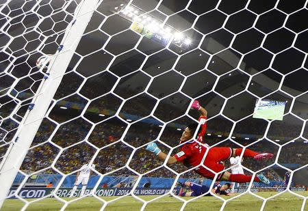 Japan's goalkeeper Eiji Kawashima tries to save a missed goal during their 2014 World Cup Group C soccer match against Greece at the Dunas arena in Natal June 19, 2014. REUTERS/Toru Hanai