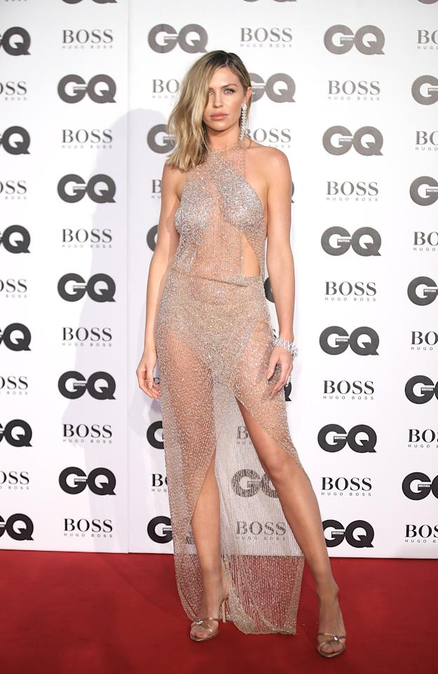 <p><strong>Wearing: </strong>A see-through Julien Macdonald dress featuring a halter-neck. <br />[Photo: Getty] </p>