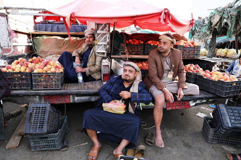 Fruit vendors chew qat, a mild stimulant, amid concerns of the spread of the coronavirus disease (COVID-19) at a fruit market in Sanaa