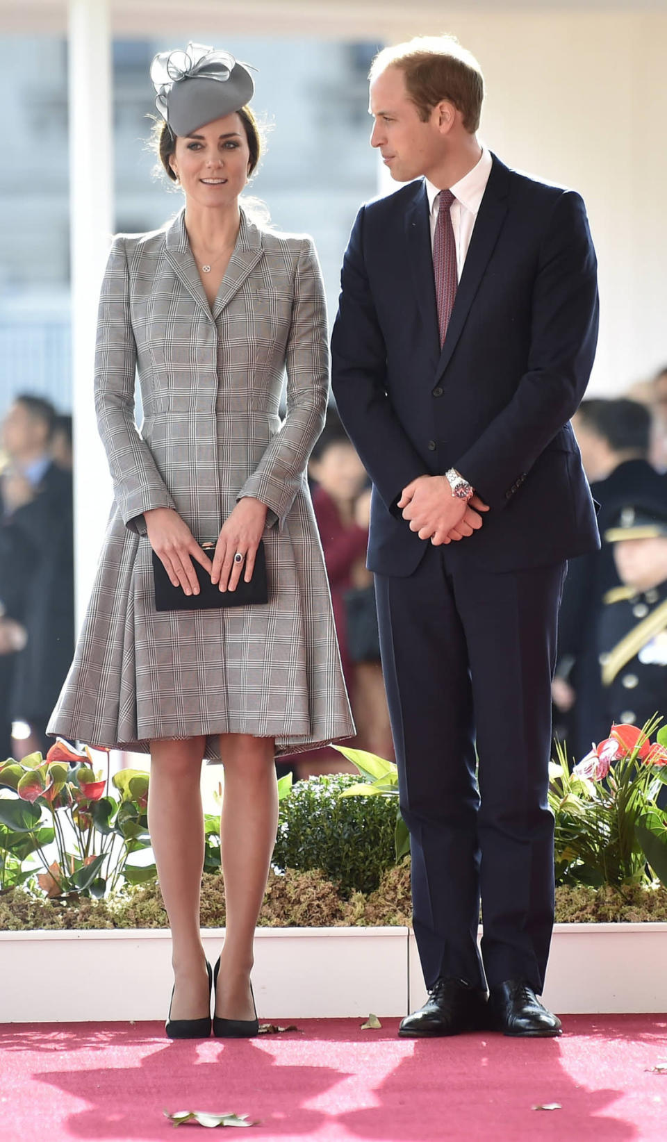 <p>Welcoming the President of Singapore, Kate chose a bespoke Alexander McQueen coat with a coordinating grey Jane Taylor hat. She carried a black suede Jenny Packham clutch and finished with Prada shoes.</p><p><i>[Photo: PA]</i></p>