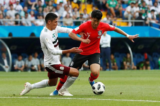 Soccer Football - World Cup - Group F - South Korea vs Mexico - Rostov Arena, Rostov-on-Don, Russia - June 23, 2018 South Korea's Son Heung-min in action with Mexico's Edson Alvarez REUTERS/Damir Sagolj