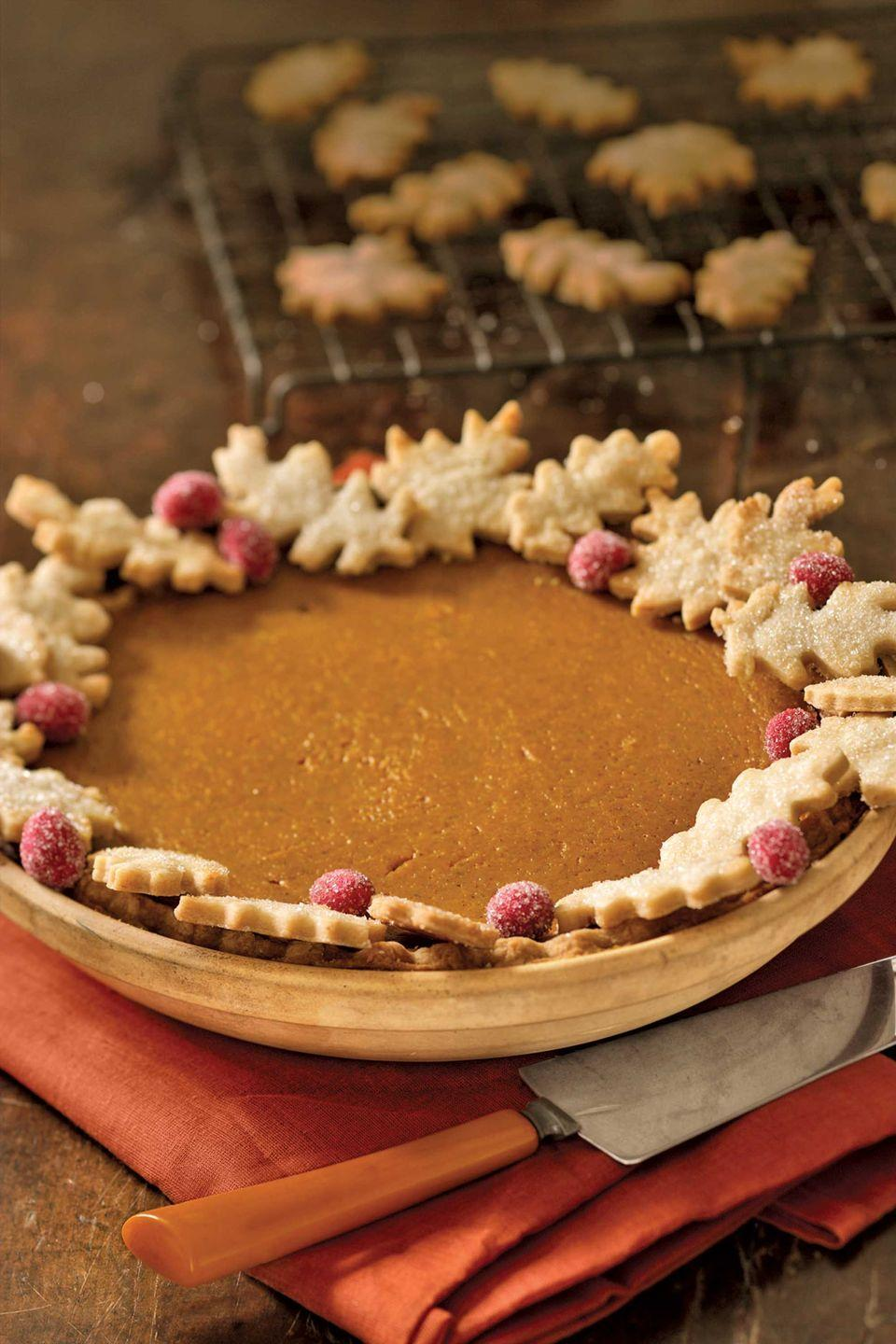"""<p>Pastry oak leaves look pretty and hide crust imperfections. For quick color, dot with fresh cranberries that you've coated with corn syrup and rolled in sugar.</p><p><strong><a href=""""https://www.countryliving.com/food-drinks/recipes/a489/pumpkin-pie/"""" rel=""""nofollow noopener"""" target=""""_blank"""" data-ylk=""""slk:Get the recipe"""" class=""""link rapid-noclick-resp"""">Get the recipe</a>.</strong></p>"""