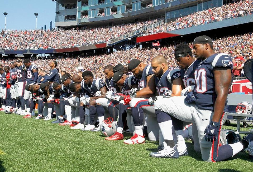 Members of the New England Patriots kneel during the National Anthem before their game against the Houston Texans, at Gillette Stadium in Foxboro, Massachusetts, on September 24, 2017 (AFP Photo/Jim Rogash)