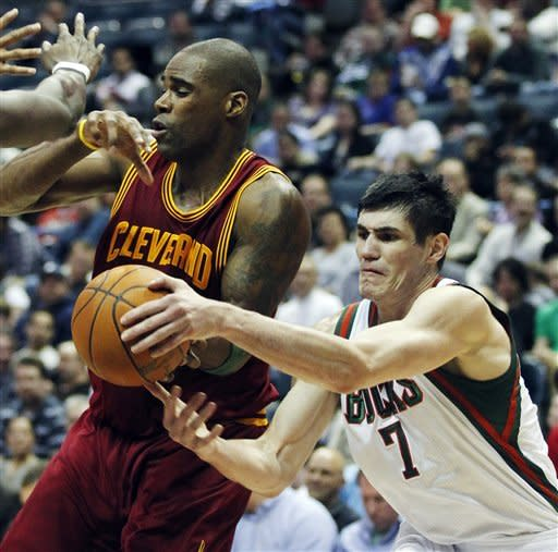 Milwaukee Bucks' Ersan Ilyasova (7) strips the ball away from Cleveland Cavaliers' Antawn Jamison, left, during the first half of an NBA basketball game, Wednesday, April 4, 2012, in Milwaukee. (AP Photo/Jeffrey Phelps)
