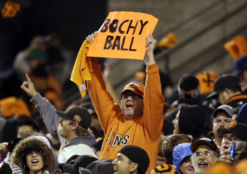 San Francisco Giants fans cheer during the eighth inning of Game 7 of baseball's National League championship series against the St. Louis Cardinals Monday, Oct. 22, 2012, in San Francisco. (AP Photo/Mark Humphrey)