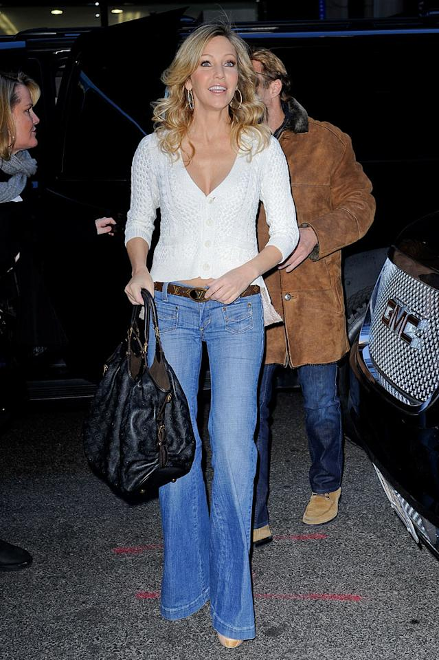 "Heather Locklear went retro in New York with a pair of bellbottoms (cinched with a fancy Louis Vuitton belt). Oh, and her fiance Jack Wagner clearly likes jeans, too -- that's him sporting a pair behind her. Ray Tamarra/<a href=""http://www.gettyimages.com/"" target=""new"">GettyImages.com</a> - March 4, 2011"