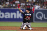 Atlanta Braves' Joc Pederson reacts after hitting an RBI double in the sixth inning of a baseball game against the San Diego Padres, Saturday, Sept. 25, 2021, in San Diego. (AP Photo/Derrick Tuskan)