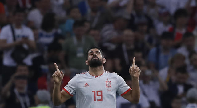 Spain's Diego Costa celebrates after scoring his sides 2nd goal during the group B match between Portugal and Spain at the 2018 soccer World Cup in the Fisht Stadium in Sochi, Russia, Friday, June 15, 2018. (AP Photo/Manu Fernandez)