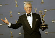 "FILE - In this Friday, April 28, 2006, file photo, Alex Trebek holds the award for outstanding game show host, for his work on ""Jeopardy!"" backstage at the 33rd Annual Daytime Emmy Awards in Los Angeles. Jeopardy!"" host Alex Trebek died Sunday, Nov. 8, 2020, after battling pancreatic cancer for nearly two years. Trebek died at home with family and friends surrounding him, ""Jeopardy!"" studio Sony said in a statement. Trebek presided over the beloved quiz show for more than 30 years. (AP Photo/Reed Saxon, File)"