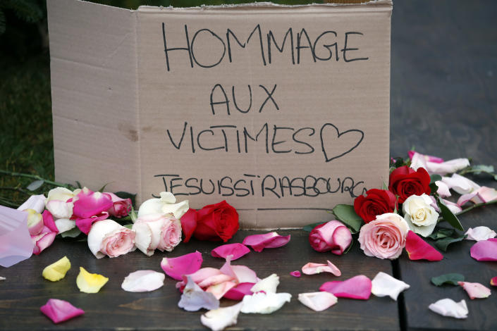 A sign honoring the victims of a shooting in Strasbourg, France
