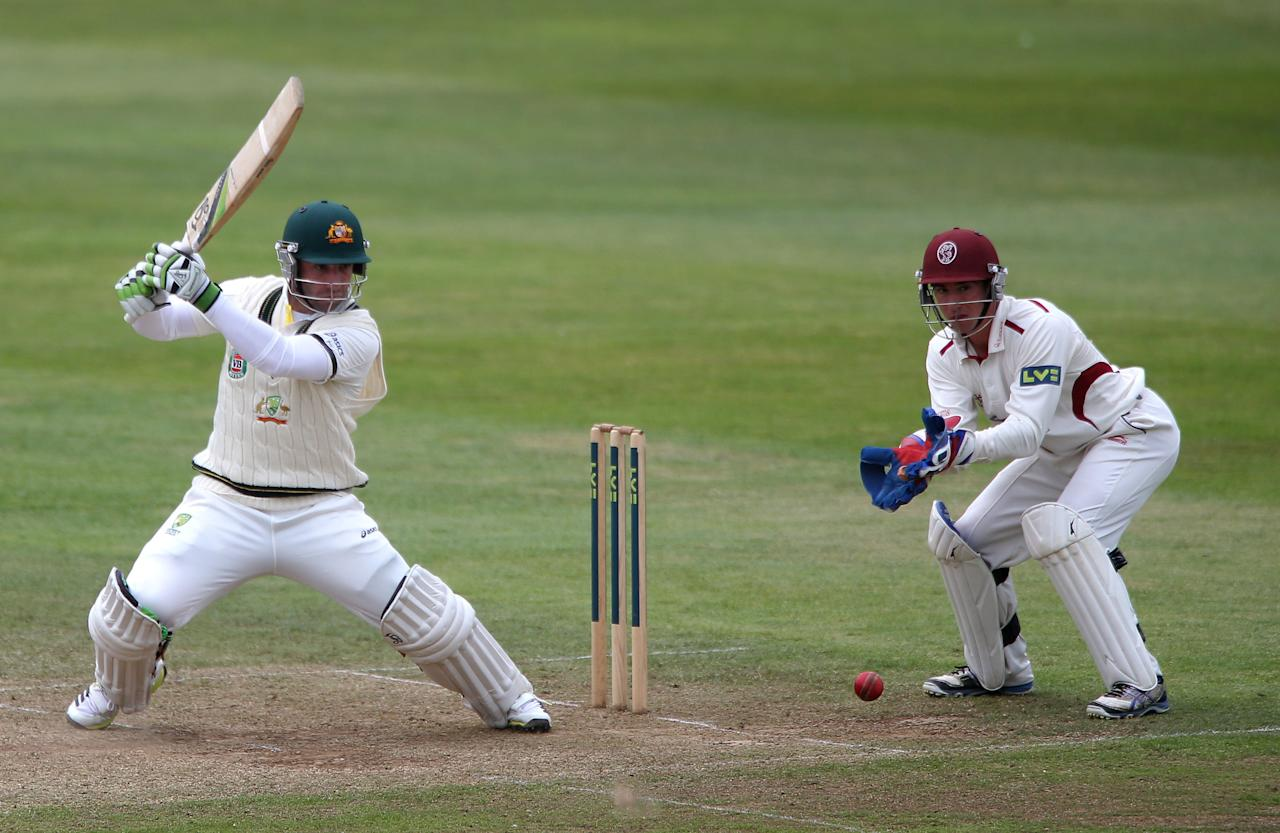 Australia's Phil Hughes hits a boundary watched by Somerset wicketkeeper Alex Barrow during the International Tour match at the County Ground, Taunton.