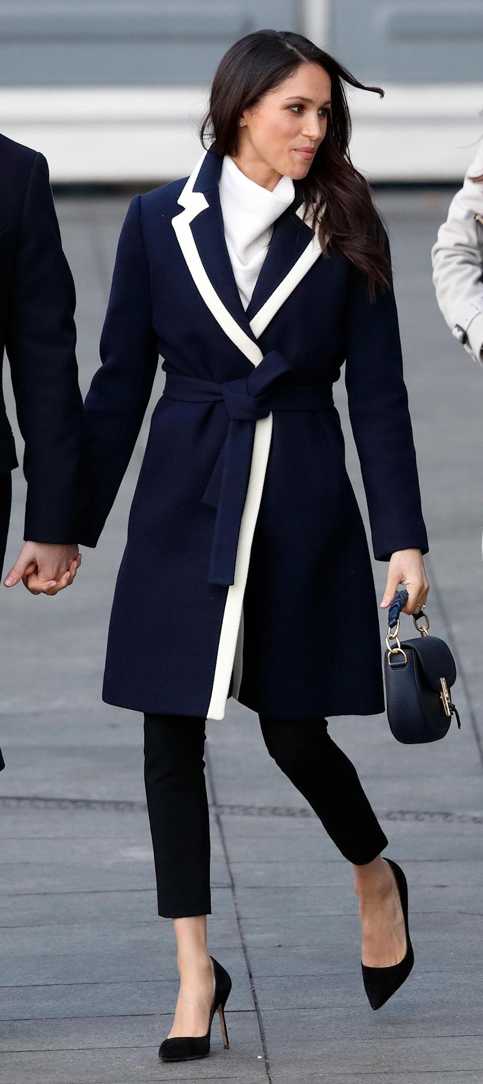 <p>The soon-to-be royal scored another fashion hit on a visit to Birmingham in a chic overcoat and black trousers (Getty Images) </p>