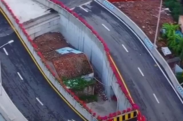 Chinese city builds bridge around woman's house after she refused to move