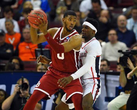 Mar 22, 2019; Columbia, SC, USA; Oklahoma Sooners guard Christian James (0) is defended by Mississippi Rebels guard Terence Davis (3) during the second half in the first round of the 2019 NCAA Tournament at Colonial Life Arena. Mandatory Credit: Bob Donnan-USA TODAY Sports