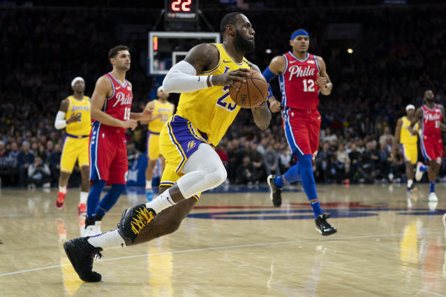 Los Angeles Lakers' LeBron James goes to the basket during the first half of an NBA basketball game against the Philadelphia 76ers, Saturday, Jan. 25, 2020, in Philadelphia. (AP Photo/Chris Szagola)
