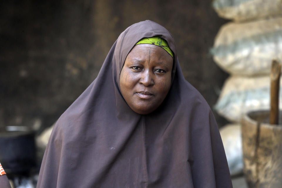 """Murjanatu Rabiu, mother of freed schoolboy Habubakar Liti, speaks with Associated Press at their family home in Ketare, Nigeria, Saturday Dec. 19, 2020. """"By the time I saw my son, I didn't know when I started crying because of the condition I saw the children, that's why I started crying."""" Nigeria's freed schoolboys have reunited with their joyful parents after being held captive for nearly a week by gunmen allied with jihadist rebels in the country's northwest. Relieved parents hugged their sons tightly on Saturday in Kankara, where more than 340 boys were abducted from the Government Science Secondary school on the night of Dec. 11. (AP Photo/Sunday Alamba)"""
