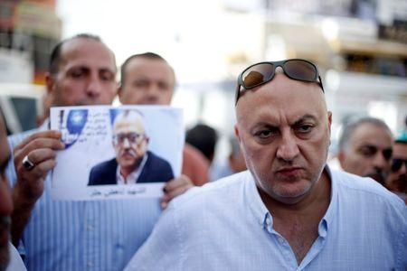 Majed Hattar (R), brother of the Jordanian writer Nahed Hattar, speaks to the media during a sit-in in the town of Al-Fuheis near Amman, Jordan, September 25, 2016. REUTERS/Muhammad Hamed