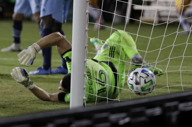 Vancouver Whitecaps goalkeeper Maxime Crepeau is unable to stop a goal by San Jose Earthquakes forward Andres Rios during the first half of an MLS soccer match Wednesday, July 15, 2020, in Kissimmee, Fla. (AP Photo/John Raoux)