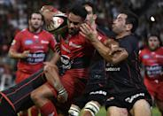 Toulouse's scrum-half Jean-Marc Doussain (R) fights for the ball with Toulon's centre Rudi Wulf during their French Top 14 rugby union match at the Ernest Wallon Stadium in Toulouse, southern France, on October 12, 2014 (AFP Photo/Pascal Pavani)