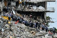 Hundreds of rescuers are working on the site of the collapsed 12-story apartment building in Surfside, Florida, but no survivors have emerged since the immediate aftermath of the disaster