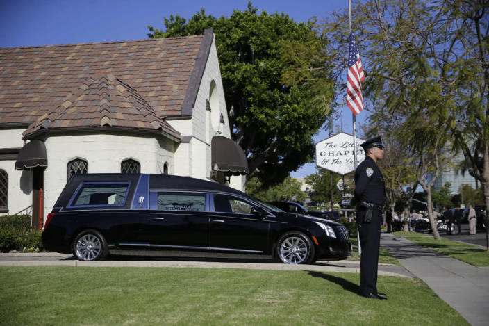 <p>A police officer stands guard outside a mortuary in advance of a small ceremony for former first lady Nancy Reagan on Wednesday in Santa Monica, Calif. <i>(Photo: Jae C. Hong, Pool/AP)</i></p>