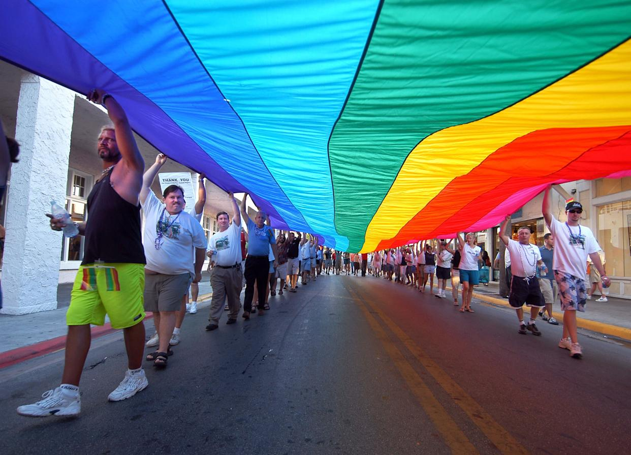 Participants walk with a 100-foot rainbow flag during the Hillsborough Pride in Exile weekend celebration Aug. 13, 2005, in Key West, Florida. (Photo: Getty Images)