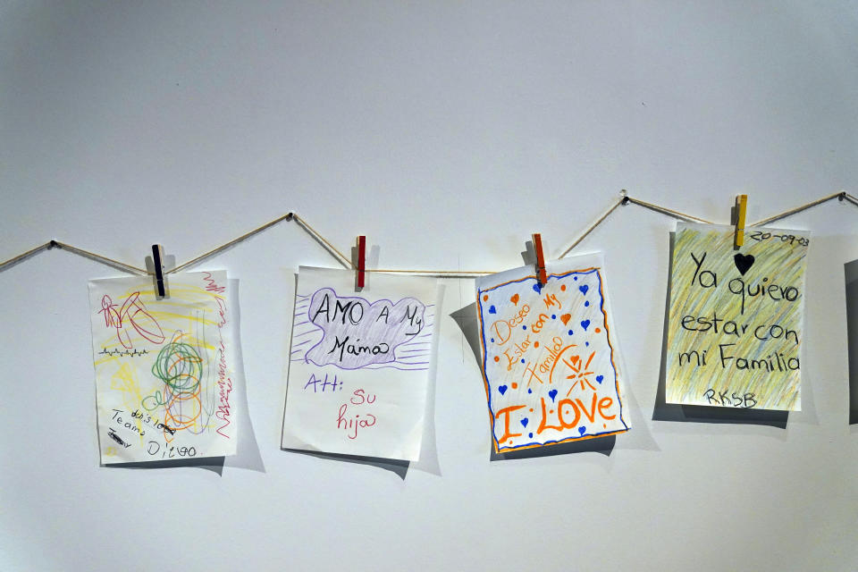 Drawings made by children are placed on a wall at an emergency shelter for migrant children Friday, July 2, 2021, in Pomona, Calif. The Biden administration on Friday gave a rare look inside an emergency shelter it opened to house migrant children crossing the U.S.-Mexico border alone, calling the California facility a model among its large-scale sites, some of which have been plagued by complaints. (AP Photo/Marcio Jose Sanchez, Pool)