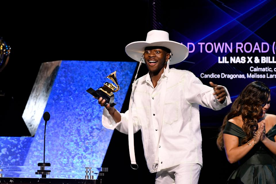 """Lil Nas X accepts the award for best music video for """"Old Town Road"""" during the Grammy Awards Premiere Ceremony."""