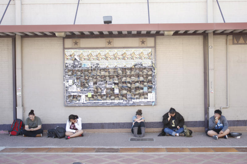 Texas A&M students wait for the campus to reopen while authorities investigate a bomb threat Friday, Oct. 19, 2012 in College Station, Texas. (AP Photo/Jon Eilts)