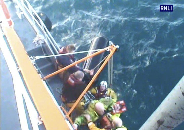 This is the dramatic moment a trawler sank just minutes after starting to take on water.