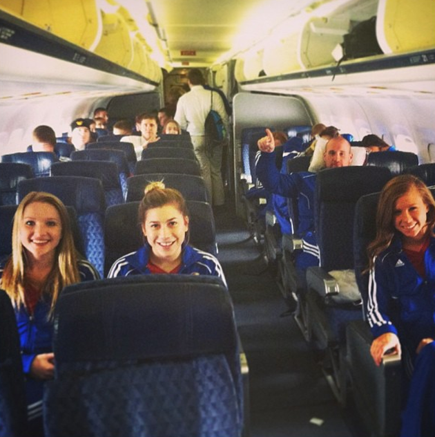 Cheerleaders from Kansas University prefer track suits when they fly.
