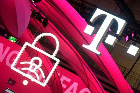 FILE PHOTO: Deutsche Telekom logo is seen during preparations at the CeBit computer fair, which will open its doors to the public on March 20, at the fairground in Hanover, Germany, March 19, 2017.  REUTERS/Fabian Bimmer/File Photo