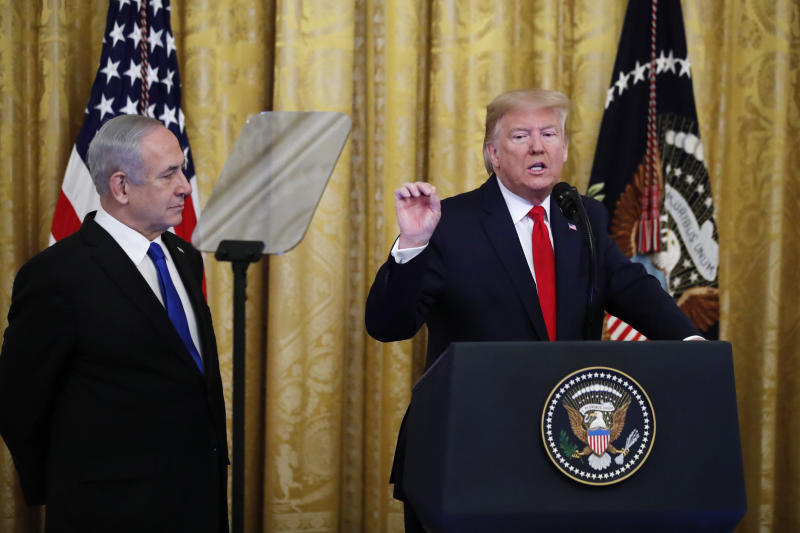 President Donald Trump, joined by Israeli Prime Minister Benjamin Netanyahu, speaks during an event in the East Room of the White House in Washington, Tuesday, Jan. 28, 2020, to announce the Trump administration's much-anticipated plan to resolve the Israeli-Palestinian conflict. (AP Photo/Alex Brandon)