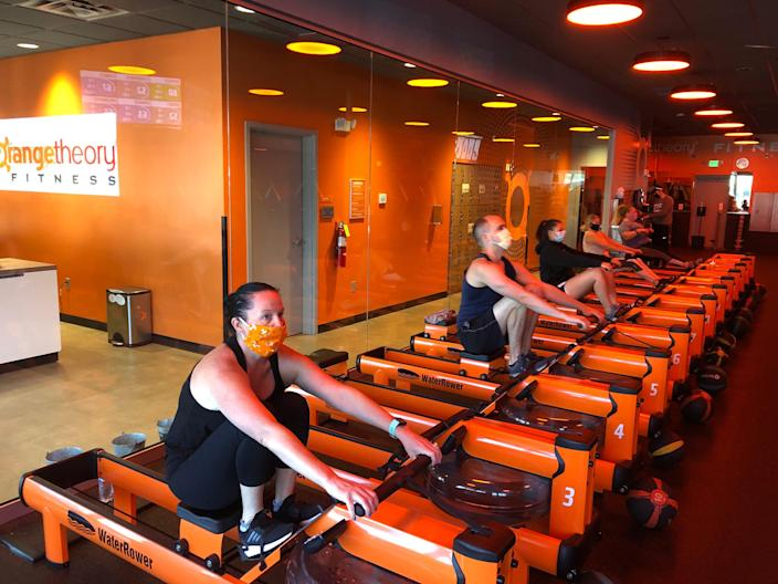 """Classes at reopened Orangetheory studios are held at limited capacity to allow for social distancing. The classes are """"mask optional."""""""