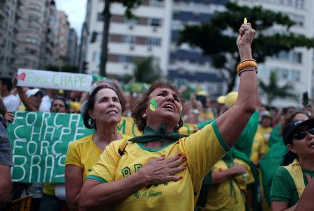 A demonstrator yells slogans during a protest against corruption at the Copacabana beach in Rio de Janeiro