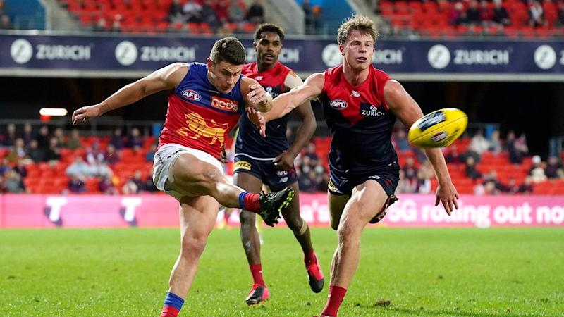 Brisbane have held on for a four-point AFL win over Melbourne on the Gold Coast