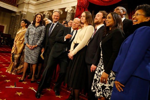U.S. Sen. Kamala Harris (D-Calif.), second from left, accompanied by her family, participates in a re-enacted swearing-in with U.S. Vice President Joe Biden in the Old Senate Chamber at the U.S. Capitol on Jan. 3, 2017 in Washington, D.C.