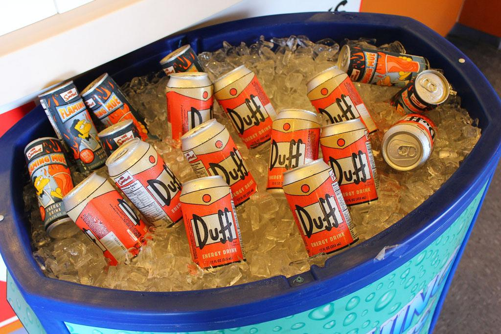 """You can save a trip to Florida for Duff Energy: It's available at Hot Topic, where you will find yourself surrounded by real-life cartoon characters.<br /><br />Check out more photos at <a href=""""http://www.insidethemagic.net/2013/06/krusty-burger-moes-tavern-open-at-universal-orlando-where-simpsons-fast-food-boulevard-offers-a-taste-of-springfield/"""" target=""""_blank"""">InsidetheMagic.net</a>"""