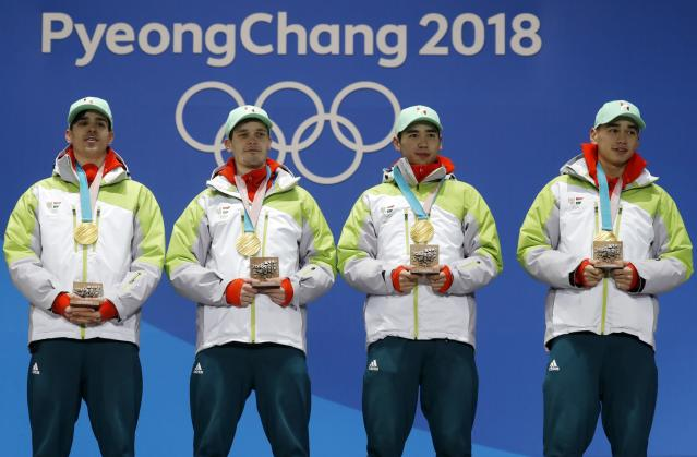 Medals Ceremony - Short Track Speed Skating Events - Pyeongchang 2018 Winter Olympics - Men's 5000m Relay - Medals Plaza - Pyeongchang, South Korea - February 23, 2018 - Gold medalists Viktor Knoch, Csaba Burjan, Liu Shaoang and Sandor Liu Shaolin of Hungary on the podium. REUTERS/Eric Gaillard