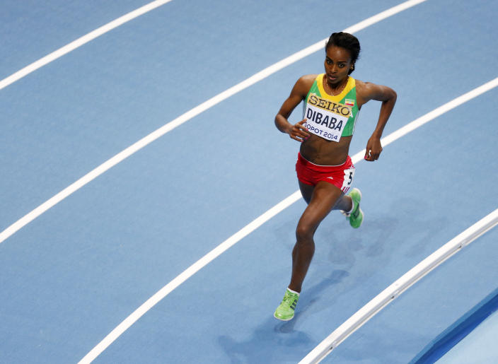 Ethiopia's Genzebe Dibaba runs in her 3000m heat during the Athletics World Indoor Championships in Sopot, Poland, Friday, March 7, 2014. (AP Photo/Petr David Josek)