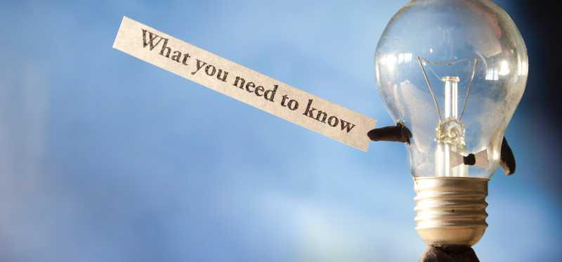 The words what you need to know held up by a lightbulb.