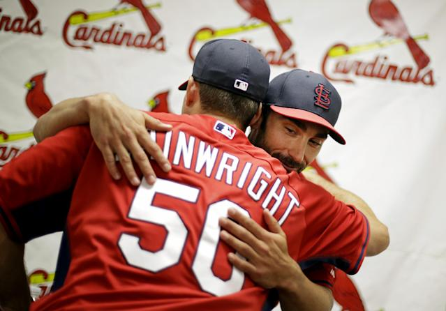 St. Louis Cardinals' Matt Carpenter, right, embraces teammate Adam Wainwright after a news conference at the team's spring training baseball facility, Saturday, March 8, 2014, in Jupiter, Fla. The Cardinals announced Saturday that they have agreed to a six-year contract extension with Carpenter for $52 million. (AP Photo/David Goldman)