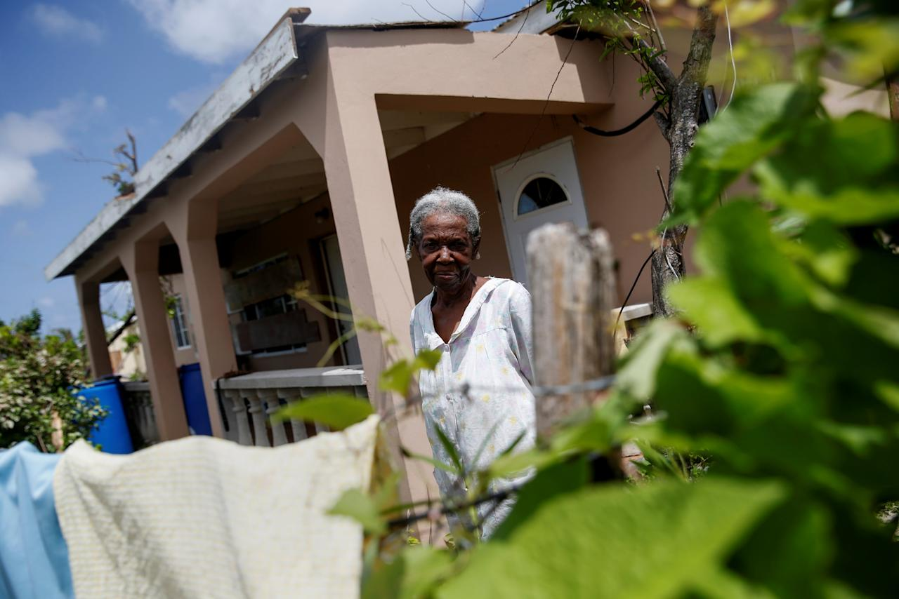 <p>Miriam Harris, 82, who stayed in her home during Hurricane Irma poses outside her home at Codrington on the island of Barbuda just after a month after the hurricane struck the Caribbean islands of Antigua and Barbuda, October 7, 2017. REUTERS/Shannon Stapleton </p>