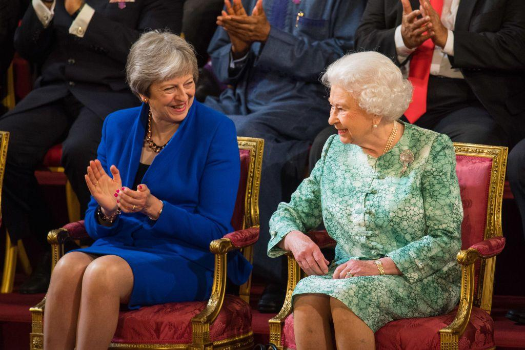 <p>Here, Theresa May and Queen Elizabeth enjoy a conversation during the opening of the 2018 Commonwealth Heads of Government Meeting, in Buckingham Palace. May began her term in 2016, and just recently stepped down.</p>